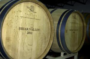 French Oak barrels rest in their racks @ Briar Valley Winery